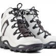 A pair of new white hiking boots on white background - Foto Stock