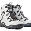A pair of new white hiking boots on white background - Stock Photo