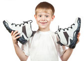Portrait of a boy with a new white shoes — Stock Photo