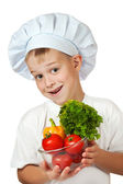 Cook boy Chef is holding fresh vegetables — Stock Photo