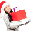 Cute girl in a Santa Claus hat. with presents — Stock Photo