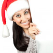 Cute girl in a Santa Claus hat. isolated — Stock Photo