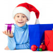 Happy kid with a lot of Christmas gifts — Stock Photo