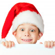 Royalty-Free Stock Photo: Funny boy in a rad Santa hat