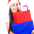 Cute girl in a Santa Claus hat. with boxes — Stock Photo