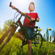 Boy with bike standing against the blue sky — Stock Photo #14915039