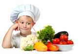 Cute scullion with raw vegetables — Stock Photo