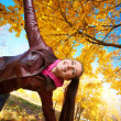 Girl on a background of  autumn leafs — Stock Photo