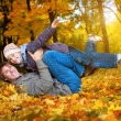 Happy dad and son in a yellow autumn park — Stock Photo #15214061