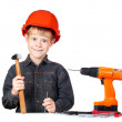 Boy in hard hat with hammer and screwdriver — Stock Photo