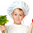 Cute boy Chef is smiling. raw vegetables — Stock Photo