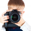 Fanny Boy is holding camera and taking a photo — Stockfoto