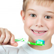 Cheerful boy is brushing his teeth — Stock Photo