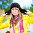 Funny girl in cap with ear flaps — Stock Photo #17822629