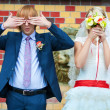 Bride and groom are standing near the patterned wall — Stock Photo