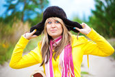 Funny girl in cap with ear flaps — Stock Photo