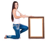 Attractive woman with picture frame — Stock Photo