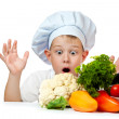 Stock Photo: Surprised cute scullion with raw vegetables