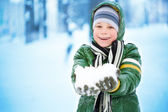 Boy is plaing with snow on the nature. Lots of snow. — Stock Photo