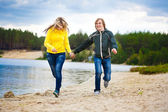 Couple are walking on the beach — Stock Photo