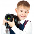 Happy Boy is holding camera and taking a photo — Stockfoto