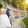 Happy couple are hugging near the ancient architectural wall — Stock Photo