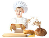 Cute scullion is kneading dough. isolated — Stok fotoğraf