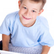 Cute boy with laptop on white. top view — Stock Photo