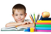 Nice boy with books and pencils — Stock Photo