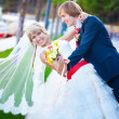 newlyweds are hugging in the green park — Stock Photo