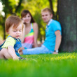 Stock Photo: Baby with parents in a beautiful summer park