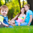 Royalty-Free Stock Photo: Little baby with parents in a summer park. picnic