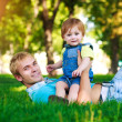 Happy daddy is playing with baby — Stock Photo