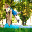 Happy daddy with baby in a greenl summer park — Stock Photo