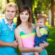 Portret baby with parents in a beautiful summer park — Stock Photo