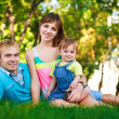 Baby with parents in a beautiful summer park — Stock Photo
