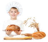 Cheerful baker boy with a loaf of rye bread — Stock Photo