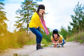 Crazy boy and girl are sledding at summer — Stock Photo