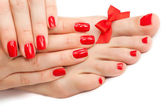 Relaxing Red manicure and pedicure with a bow. isolated — Stock Photo