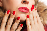 Part of the girl's face with red lips and manicure — Stock Photo