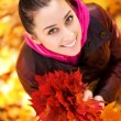 Girl on a background of autumn leafs. top view — Stock Photo #19266731