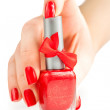 Stock Photo: Hand with red manicure and nail polish. isolated