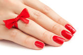 Fingers with red manicure isolated — Stock Photo