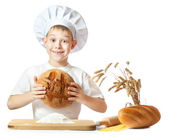 Funny little scullion is kneading dough — Stock Photo