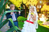 Happy couple in a sunny summer park — Stock Photo