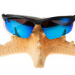Stock Photo: Starfish in sunglasses on vacation. isolated
