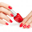 Stock Photo: Manicure. applying nail polish. isolated