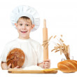 Little baker boy with a loaf of rye bread and rolling pin — Stock Photo