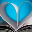 Sign of heart with book pages on blue — Stock Photo #19876617