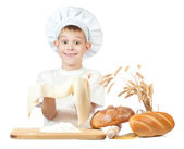 Little baker is kneading dough — Stock Photo